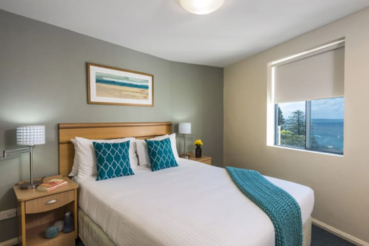 bedroom with double bed and views of The Entrance NSW