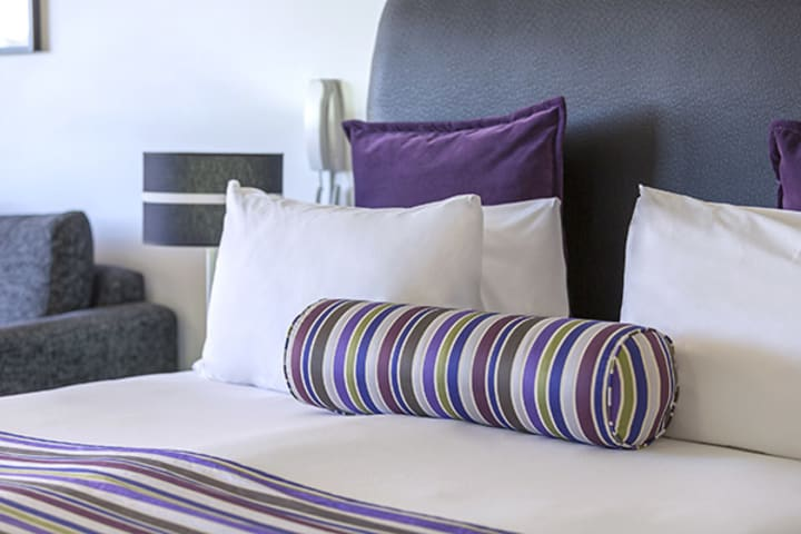 pillows and bed sheet walk at studio executive of oaks hyde park sydney hotel