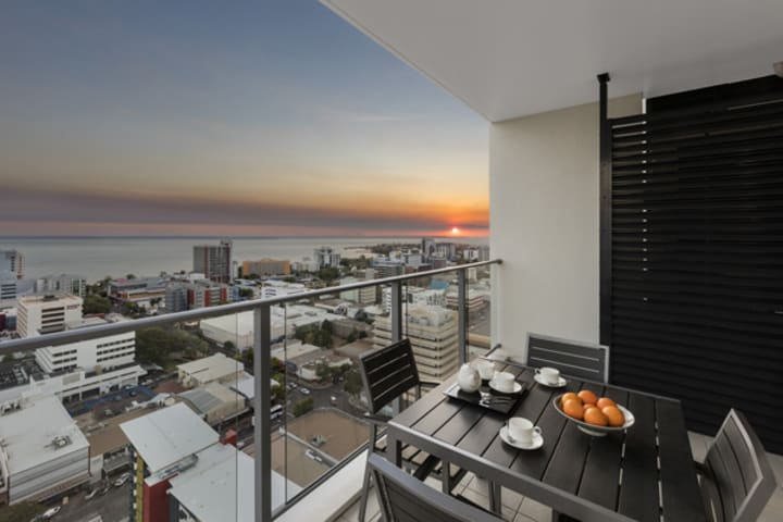 views of spectacular sunrise from balcony of Oaks Elan Darwin 1 bedroom apartment