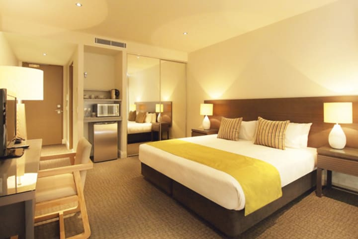 large air conditioned bedroom in hotel room at Mon Komo Hotel in Redcliffe, Queensland, Australia