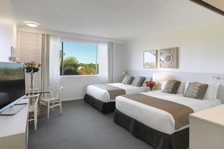 air conditioned bedroom in Caloundra accommodation with wi-fi and Foxtel on TV in Executive Family hotel room at Oaks Oasis Resort in Caloundra on Sunshine Coast, Queensland, Australia