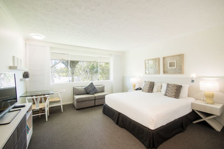 air conditioned bedroom with queen size bed and TV with Foxtel in Executive King hotel room apartment at Oaks Oasis Resort in Caloundra on Sunshine Coast, Queensland, Australia
