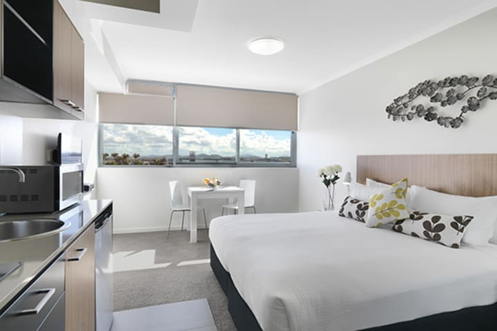 affordable Studio room apartment with microwave, air conditioning and large bed at Oaks Rivermarque hotel in Mackay, Queensland, Australia