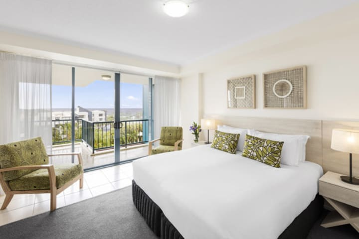 Sunshine Coast resorts with balcony and queen size bed, comfortable couch in air conditioned 3 bedroom apartment at Oaks Seaforth Resort hotel, Sunshine Coast, Queensland, Australia
