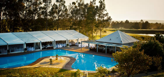 large pool hosting event in Hunter Valley with guests enjoying food service