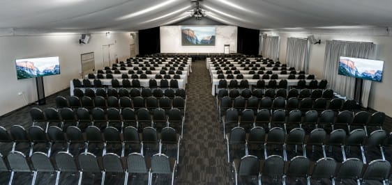large functions room in hunter valley with tv screens and projector