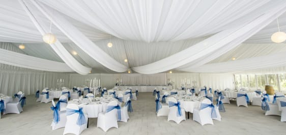 large wedding event venue with hanging drapes and table configuration in hunter valley