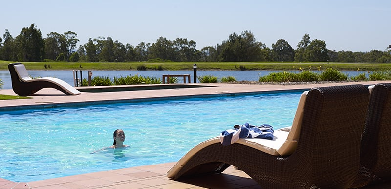 swimming pool with family swimming in hunter valley