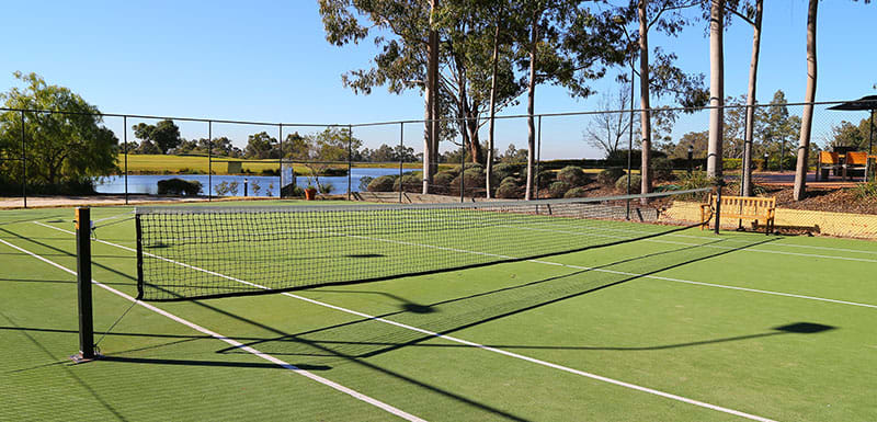 tennis court facilities at oaks cypress lakes in hunter valley family friendly holiday resort