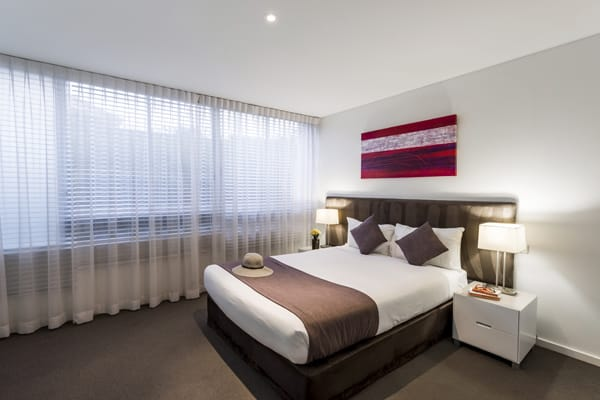 spacious bedroom in one bed apartment at oaks lure hotel in port stephens