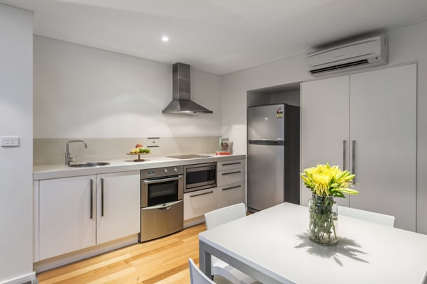 large hotel kitchen with fridge stove top microwave and oven with aircon in port stephens
