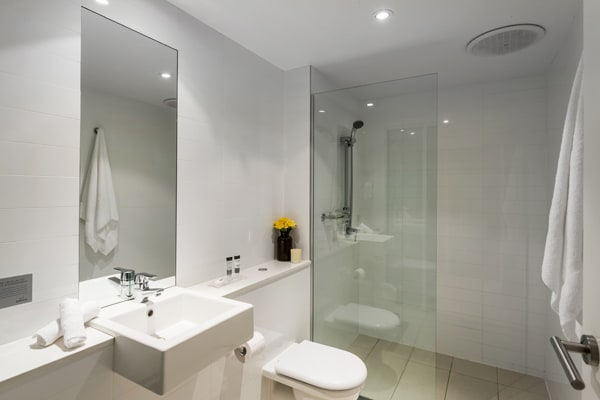 oaks lure hotel bathroom with toilet and large mirror