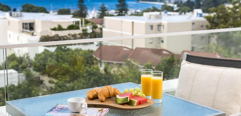 balcony with fresh breakfast served at oaks lure hotel accommodation with views of port stephens and nelson bay