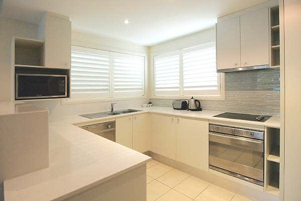 kitchen at oaks pacific blue resort with hotel oven microwave kettle toaster and stove top