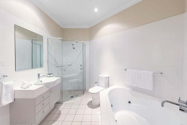 bathroom with hot tub at oaks pacific blue resort hotel in port stephens