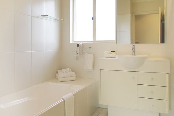 bathroom in 2 bedroom lagoon hotel room at oaks pacific blue resort with bathtub