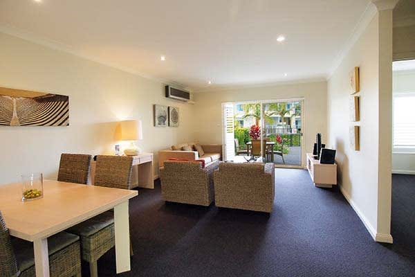 spacious living room at oaks pacific blue resort hotel accommodation