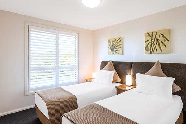 2 single beds in second bedroom at oaks pacific blue resort in port stephens near salamander bay