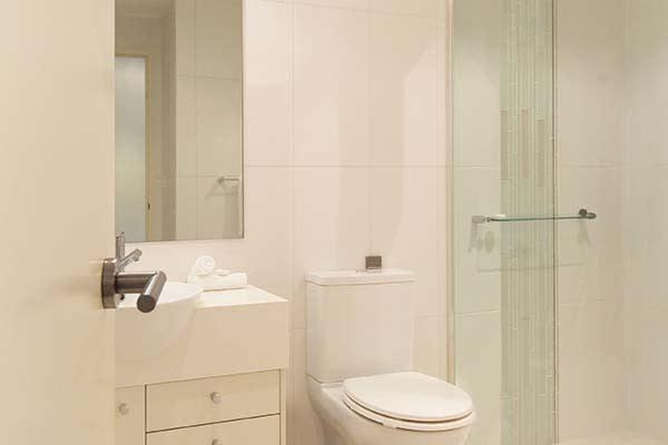 en suite bathroom in studio lagoon apartment at oaks pacific blue resort