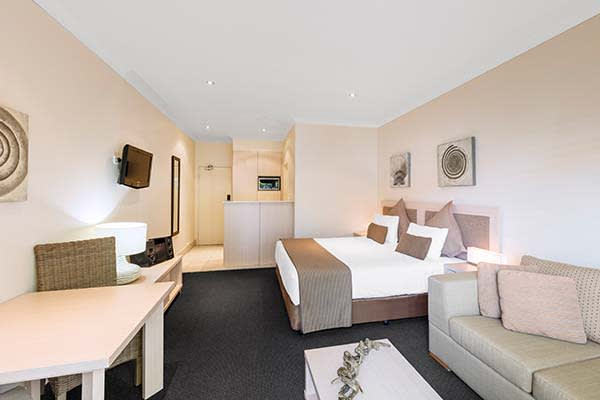 extra large bedroom with big bed en suite bathroom at oaks pacific blue resort in port stephens