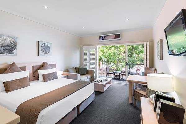 en suite hotel apartment in Port Stephens resorts studio bedroom accommodation at Oaks Pacific Blue Resort with flat screen tv and balcony