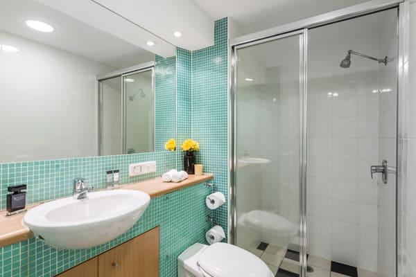 en suite bathroom hotel sink and shower