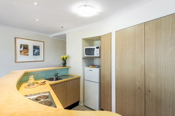 hotel accommodation with kitchen microwave and full size refrigerator