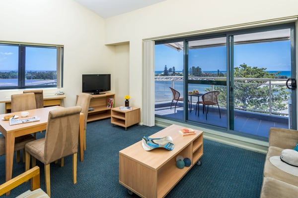 large living room at oaks waterfront resort hotel accommodation in The Entrance NSW Australia