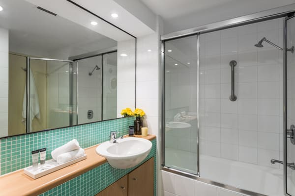 shower and toilet in en suite bathroom in 2 bedroom hotel apartment