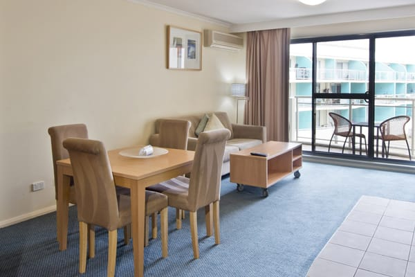 living room area in studio hotel apartment with balcony and outdoor furniture