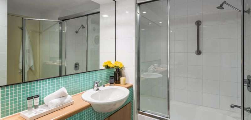 hotel room with en suite bathroom and shower