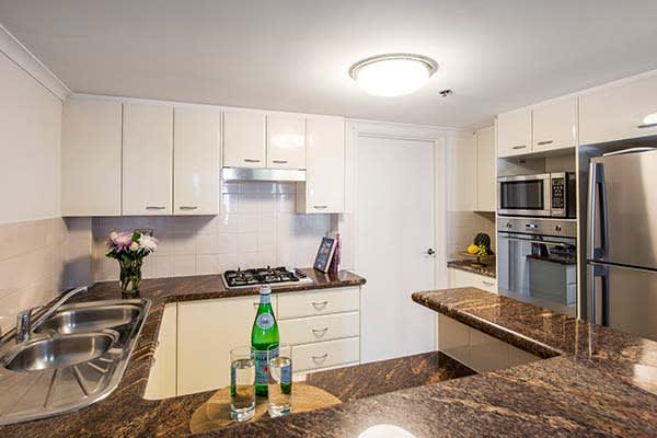 large open plan kitchen in Sydney cbd hotel with microwave, refrigerator and hot plate for preparing meals