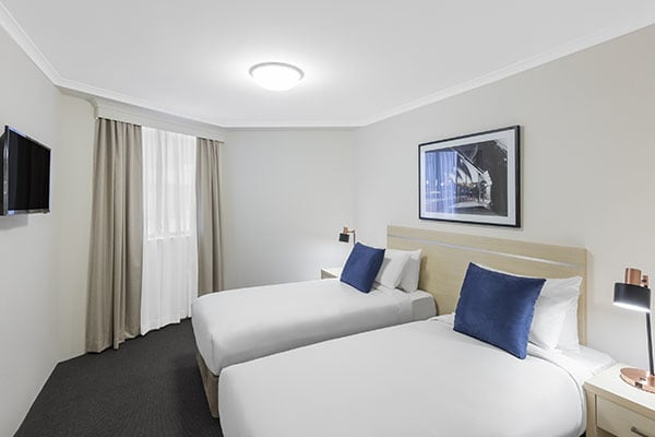 twin beds at two bedroom apartment of oaks on castlereagh sydney hotel