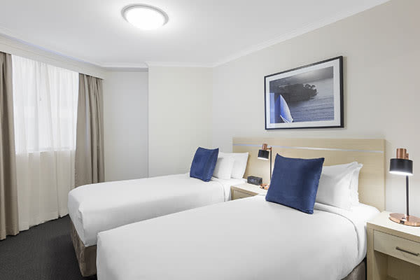 two single beds at two bedroom apartment of oaks on castlereagh sydney hotel