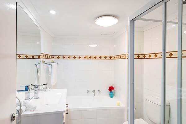 en suite hotel bathroom with bathtub shower and toilet