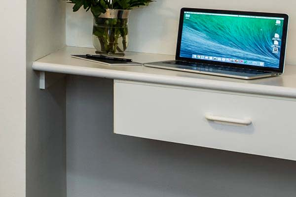 work space with laptop and drawers for storage