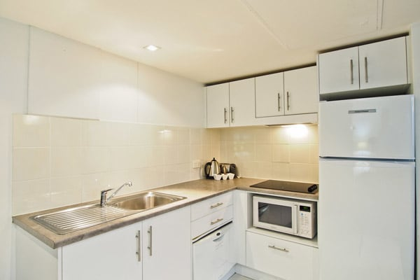 kitchen with microwave and fridge in 4 star hotel apartment, Hyde Park, Sydney