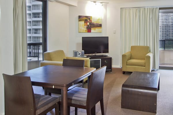 hotel 1 bedroom apartment with living room and flat screen television near Hyde Park in Sydney