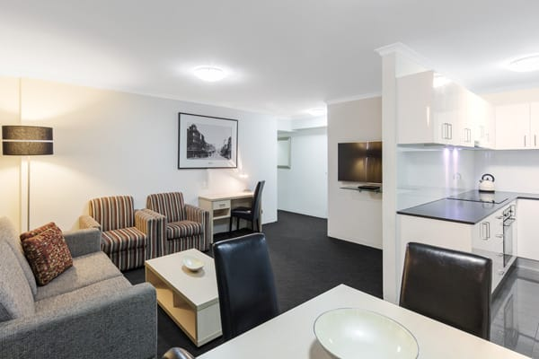 open plan kitchen and living room area in 2 bed hotel apartment near Sydney CBD