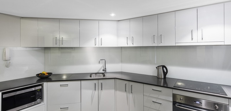 big kitchen with modern appliances including microwave, kettle and oven in 2 bedroom apartment at oaks Hyde Park Plaza hotel in Sydney