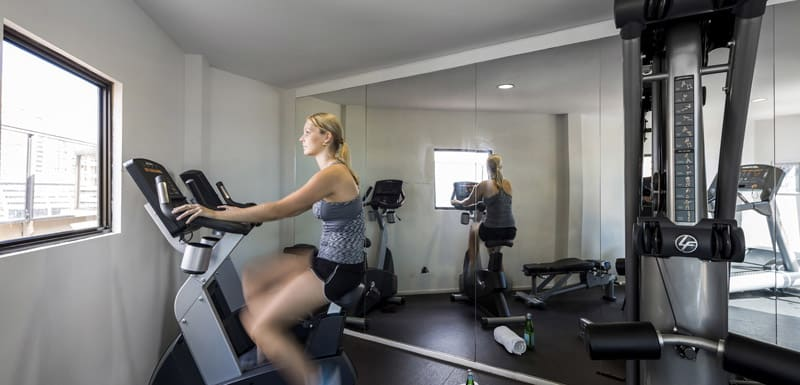 corporate traveller using gym at Oaks Hyde Park Plaza during business trip to Sydney