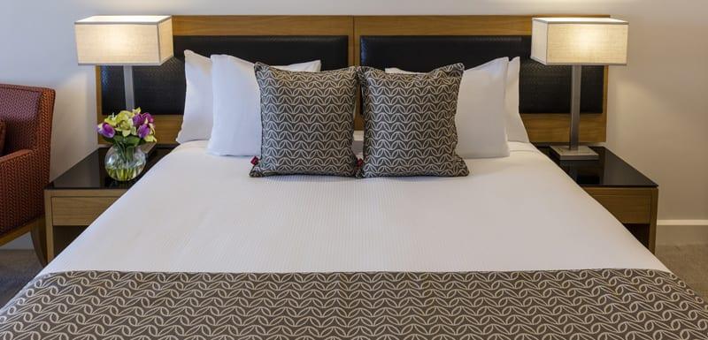 queen size bed in 2 bedroom hotel apartment in Darwin, Australia