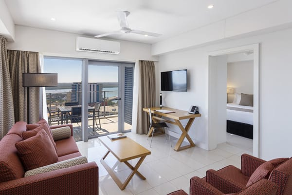 2 bed apartment living room with air conditioning, plasma screen tv and balcony at Oaks Elan Darwin hotel