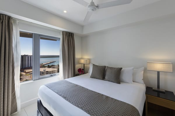 master bedroom with queen size bed at 2 bedroom apartment accommodation in Darwin