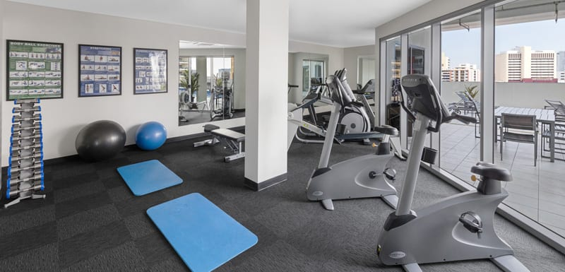 air conditioned gymnasium with weights, yoga mats, medicine balls and cycling machines in Darwin, Northern Territory, Australia
