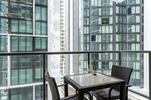 Balcony with outdoor table and chairs at 1 Bedroom apartment of Oaks 212 Margaret brisbane hotel
