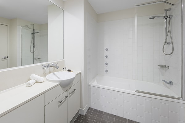 clean bathroom with bathtub at 1 Bedroom apartment of Oaks 212 Margaret brisbane hotel