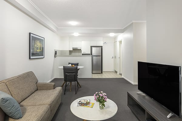 comfy living room next to fully equipped kitchen at 1 Bedroom apartment of Oaks 212 Margaret brisbane hotel