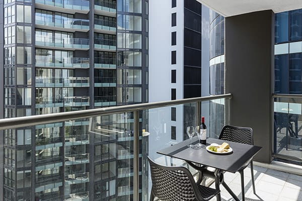 Balcony with outdoor table and chairs at 1 Bedroom executive apartment of Oaks 212 Margaret brisbane hotel