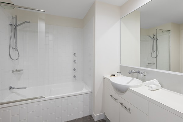 clean bathroom with bathtub at 1 Bedroom executive apartment of Oaks 212 Margaret brisbane hotel